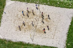Aerial view of a volleyball lesson on the sand court of the Rudolf-Steiner-School in Ismaning, Munich - Klaus Leidorf Aerial Photography