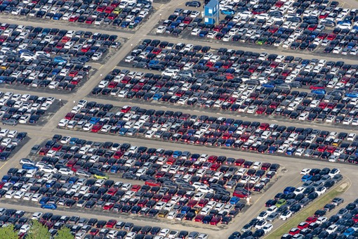 Aerial view of reflecting brake lights on parked new cars - Klaus Leidorf Aerial Photography