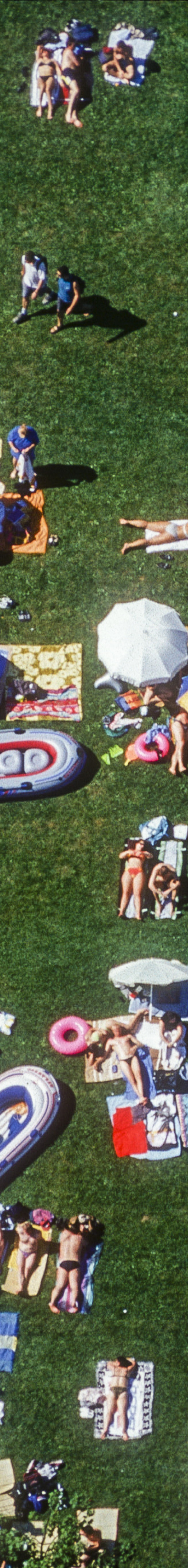 Aerial view of many people on the lawn at the open-air swimming pool in Elchingen - Klaus Leidorf Aerial Photography