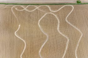 Aerial view of wavelike tracks on the field - Klaus Leidorf Aerial Photography