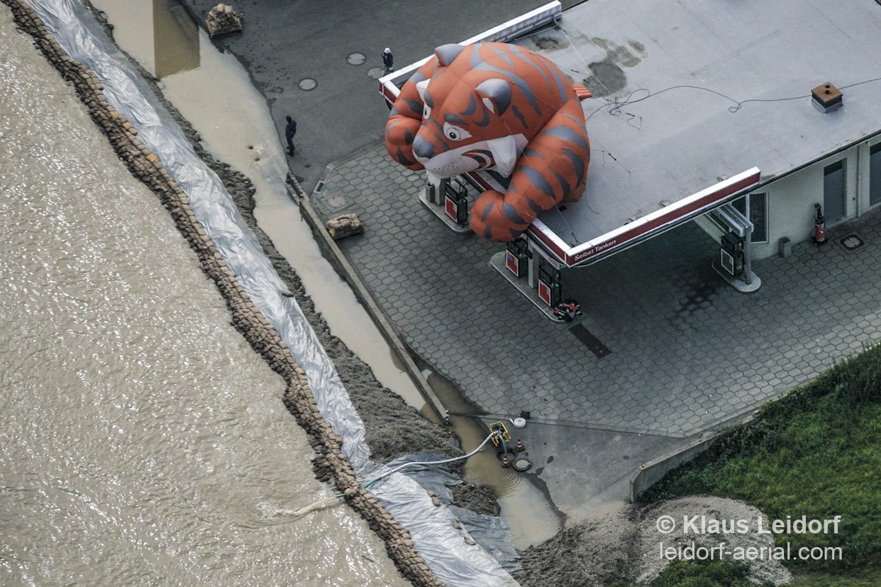 Aerial of preventing the flood of the Danube river reach a petrol station in Kelheim. 2005-08-25