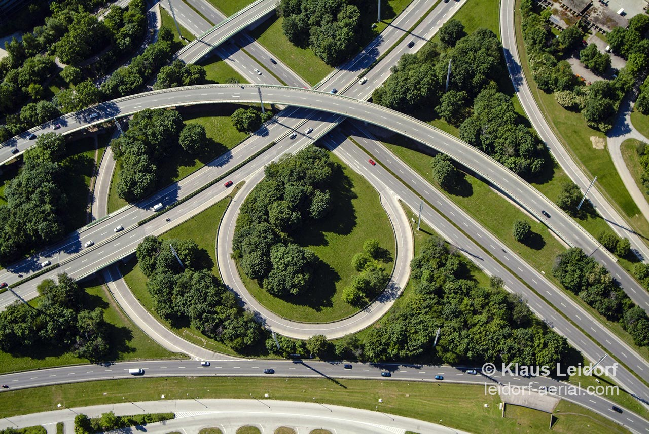 Aerial of the crossing of two major ring roads in Munich without touching each other through curves and bridges. 2004-06-08